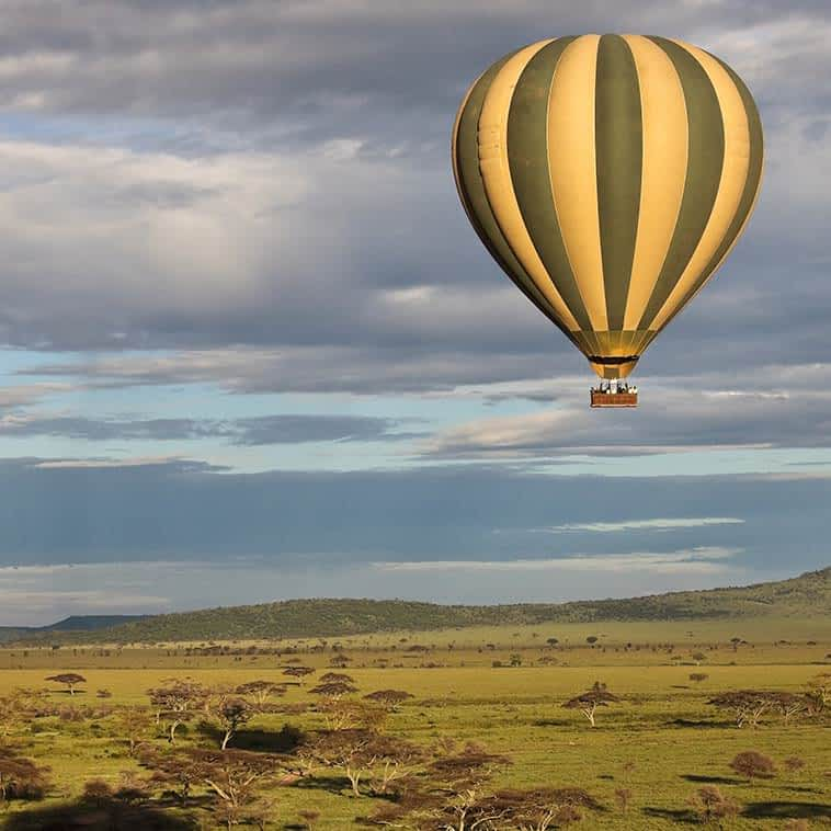 Enjoy endless views during a balloon safari in Serengeti