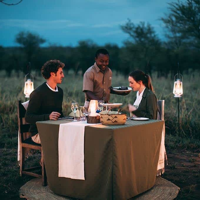 At Serengeti Tortilis Camp you can enjoy a romantic private dinner in the Serengeti